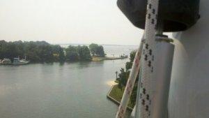 Aloft a 60 foot catameran's rigging with a view of solomon's island