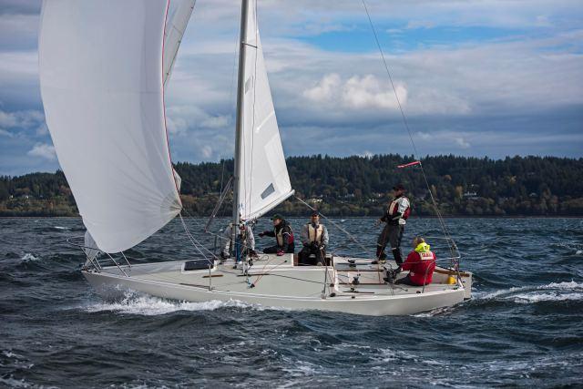 j24 sailing downwind.