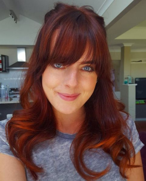 auburn and copper balayage hair with bangs