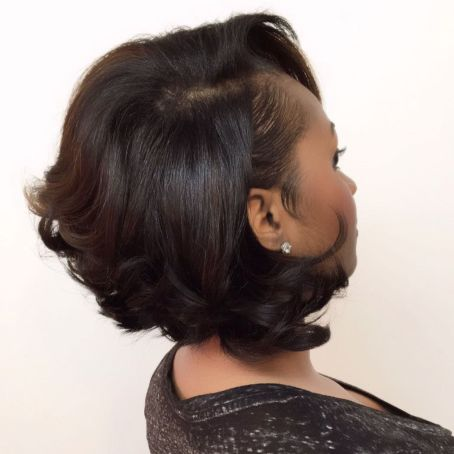 Short Black Bob Hairstyle With Side Bangs