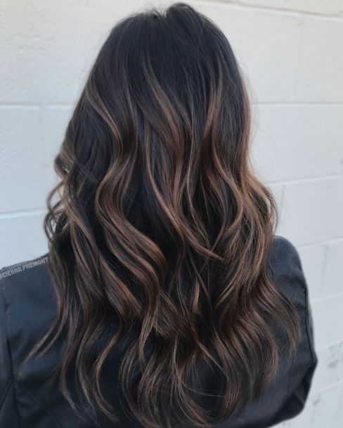 Long Layered Black Hairstyle With Highlights