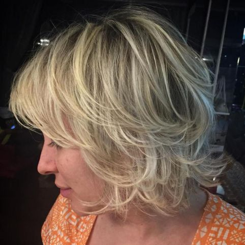 Chin-Length Layered Hairstyle With Bangs