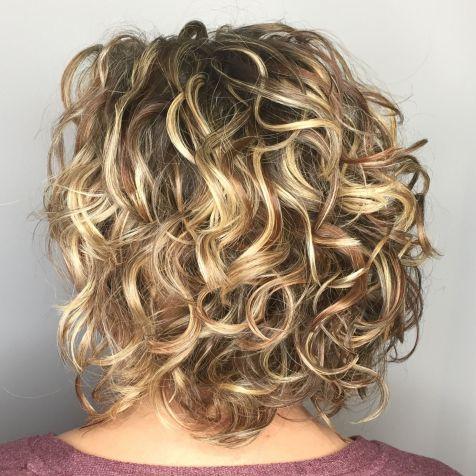 Medium Shaggy Curly Cut With Highlights
