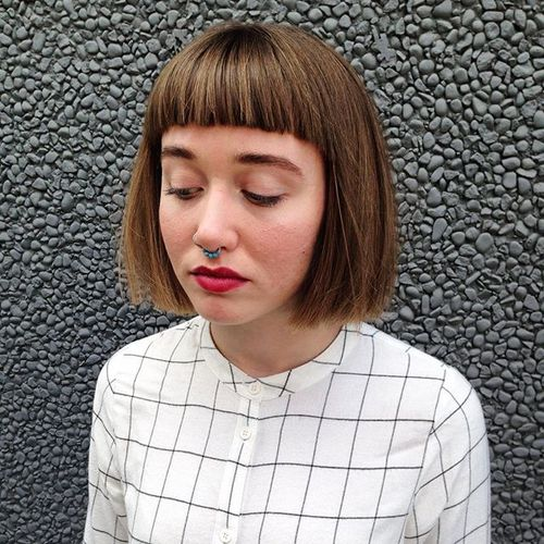 blunt chin-length bob with subtle highlights