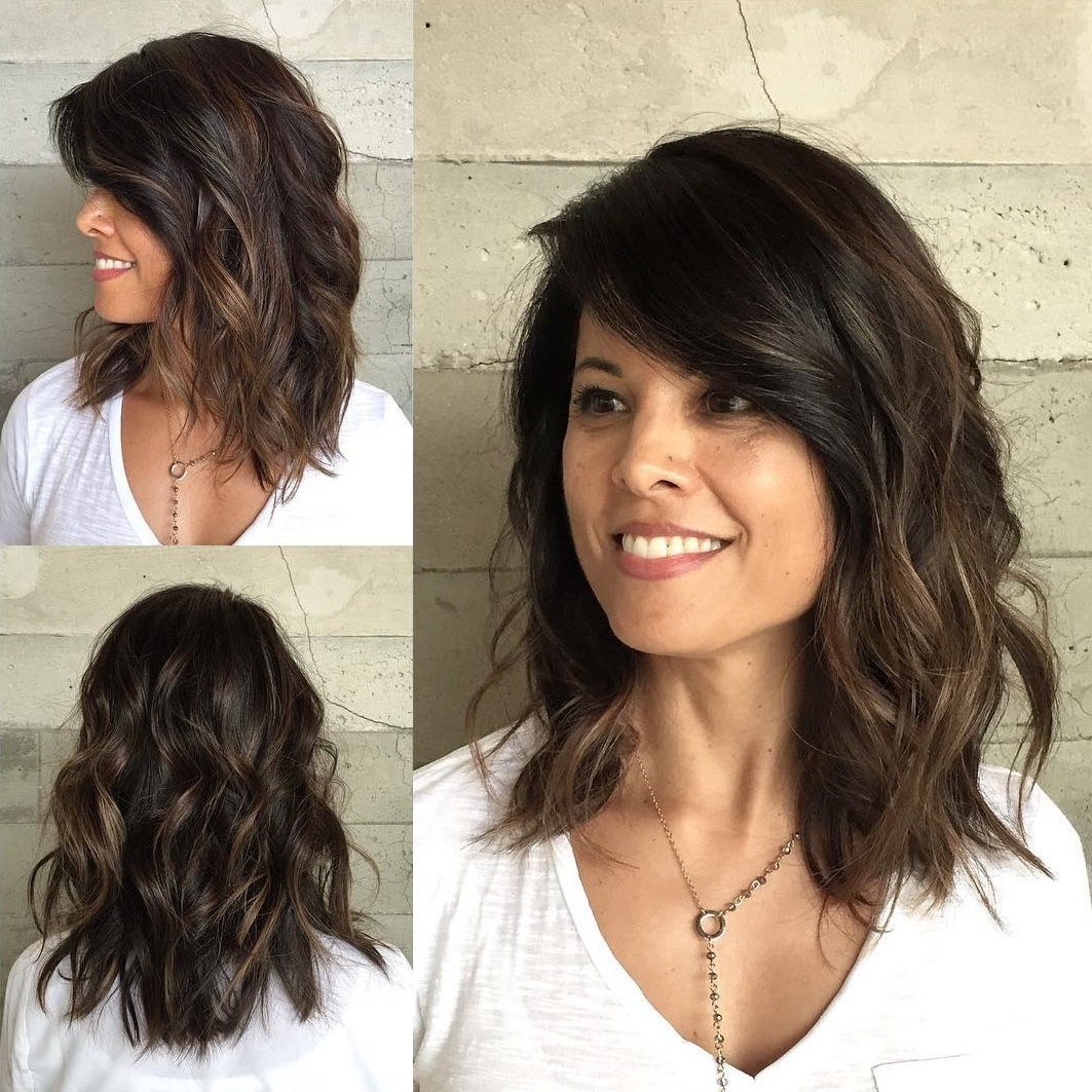 Shoulder length curly hair with long bangs