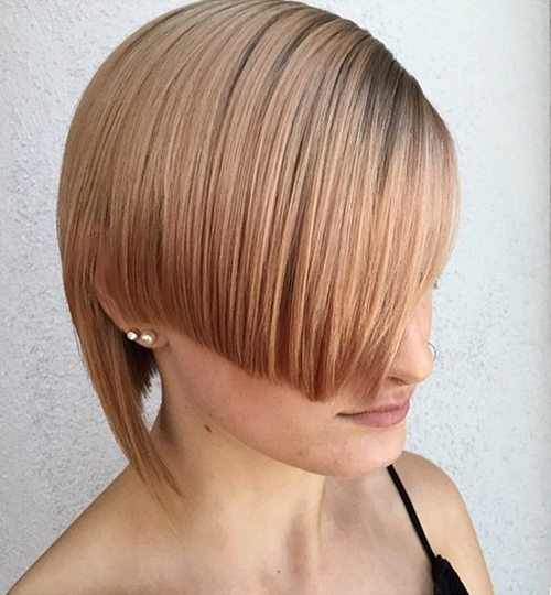 short angled asymmetrical strawberry blonde hairstyle