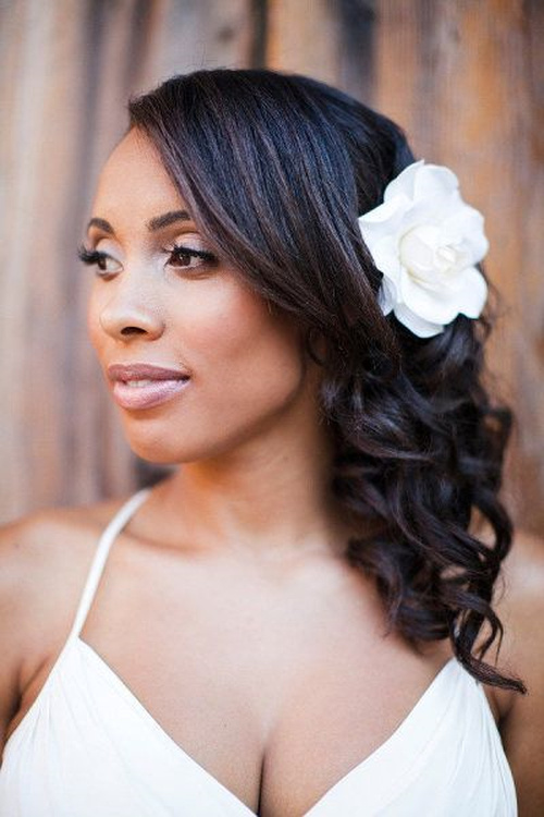 medium black curly hairstyle for brides