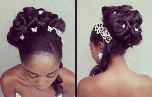 voluminous black wedding rosette updo