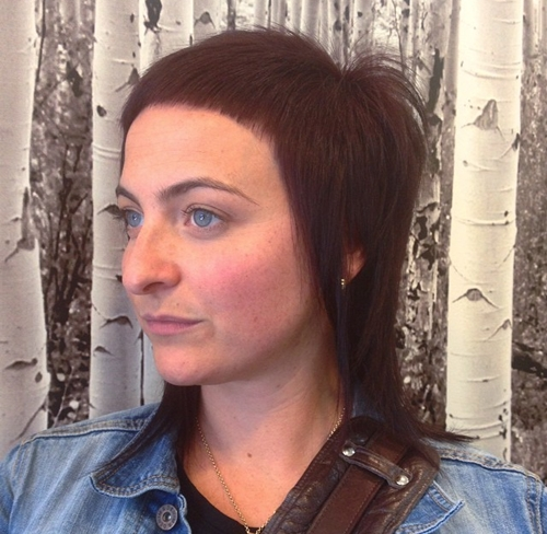medium layered haircut with extra short bangs