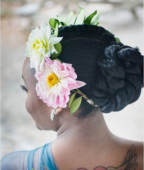 black twisted bun updo with hair flowers