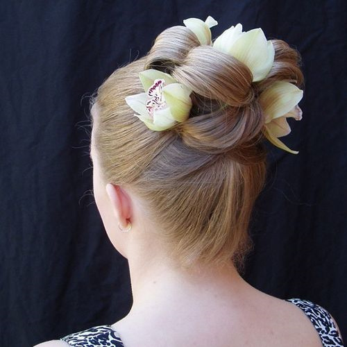 sleek updo with flowers