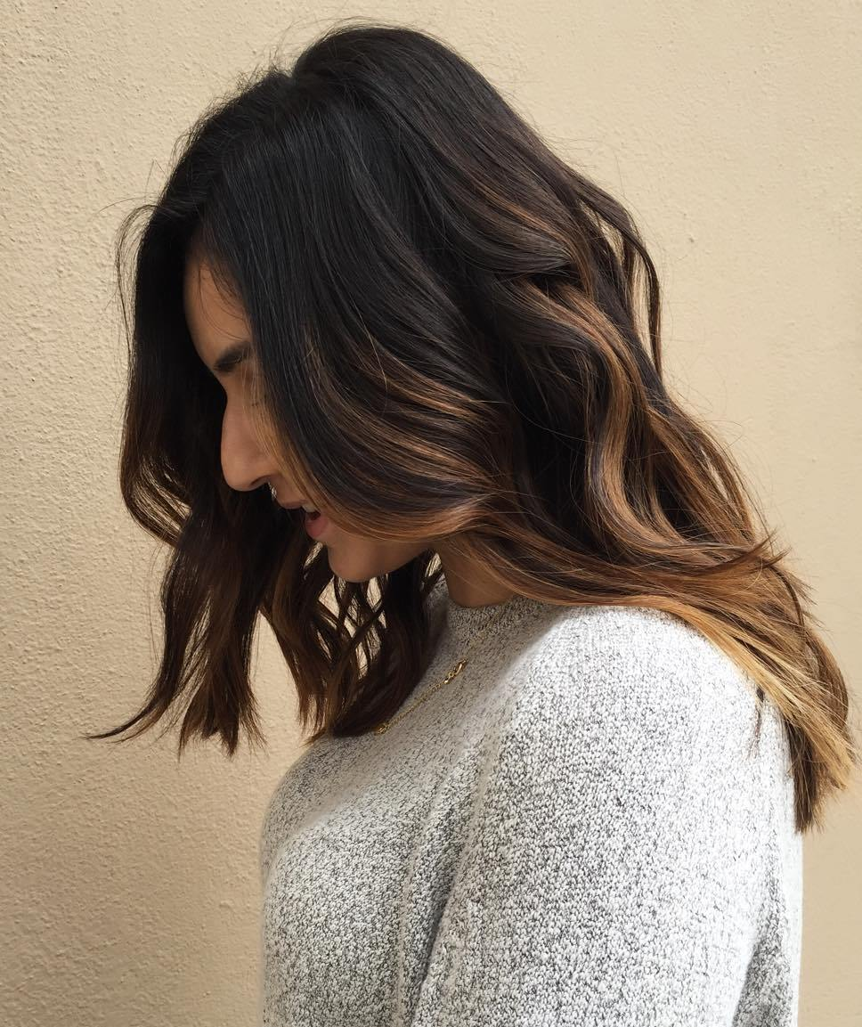Medium Layered Brunette Hair With Highlights