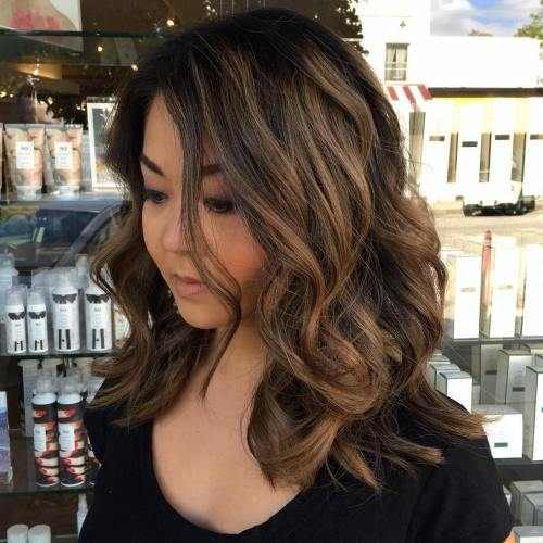 Medium To Long Wavy Brunette Hairstyle