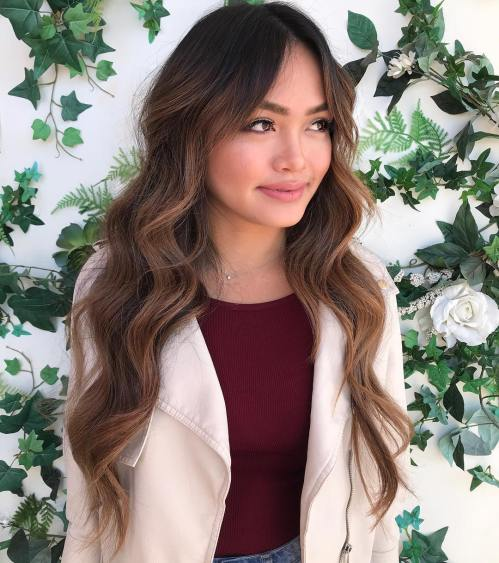 Long Wavy Layered Brunette Hairstyle