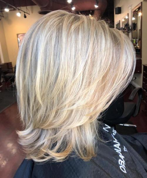 Above-The-Shoulder Feathered Blonde Haircut