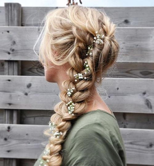 loose curly braid with rose buds for prom