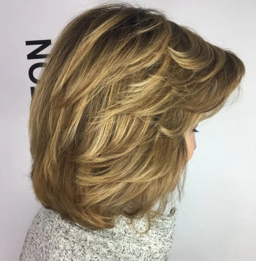 Medium Feathered Hairstyle For Thick Hair