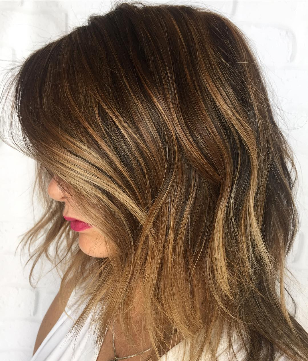 Choppy Medium Hair With Caramel Highlights