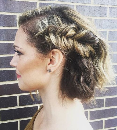 loose updo with a side fishtail