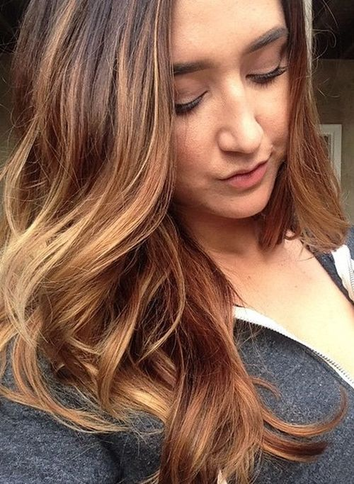 layered hairstyle with caramel highlights