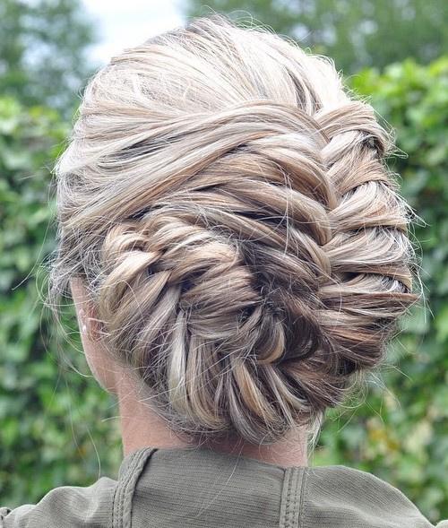 asymmetrical blonde fishtail updo