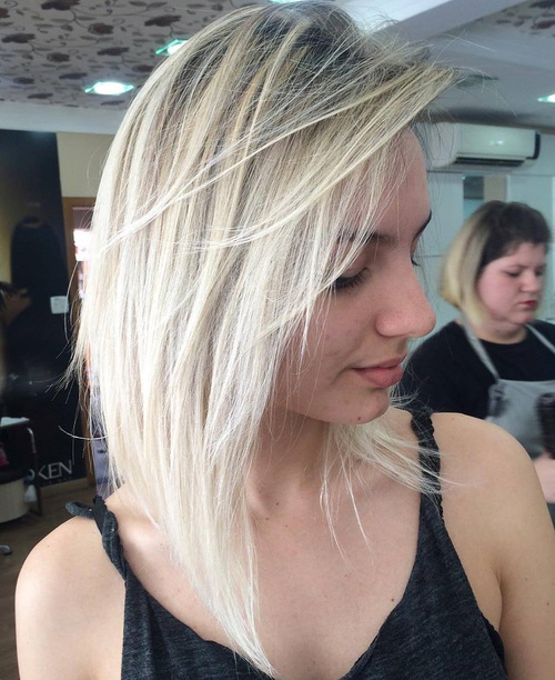 Blonde Layered Bob With Root Fade