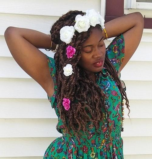 kinky twists hairstyle with hair flowers