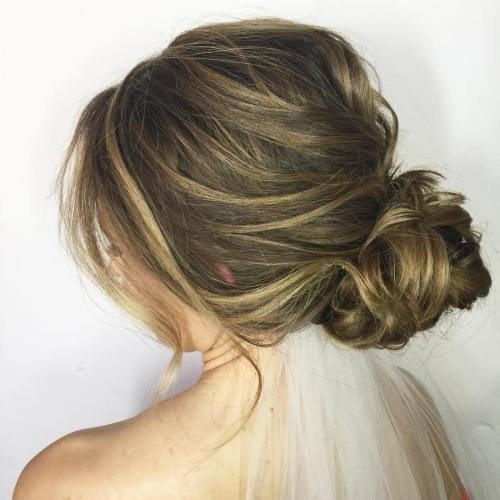 60 updos for thin hair that score maximum style point low messy bun for long hair urmus Gallery