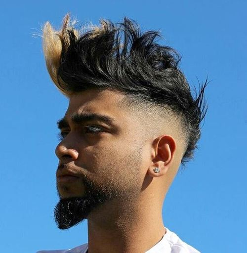 tousled mohawk hairstyle with a bleached piece