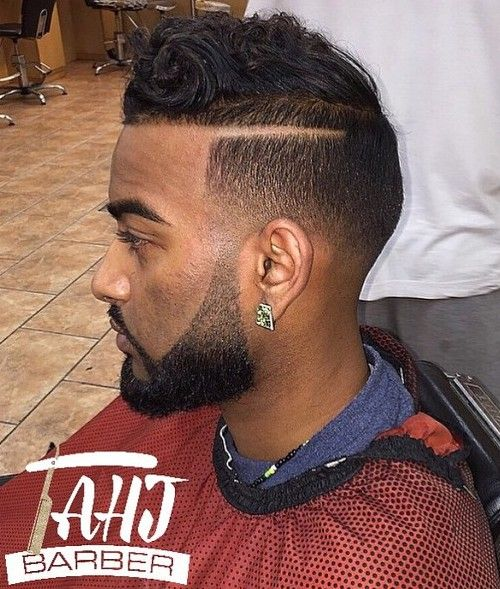 fade haircut for black men with a shaved part line
