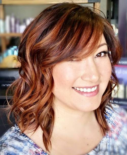 long wavy bob with bangs for round faces