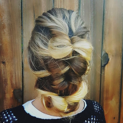 loose updo with hair bows