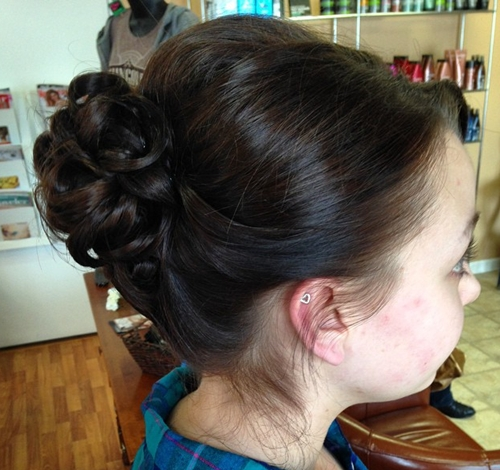 formal curly bun for medium hair