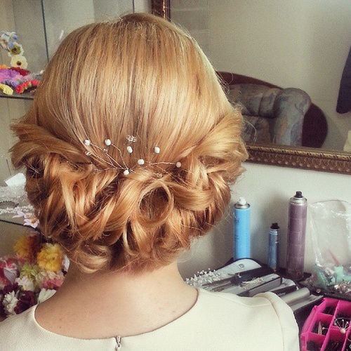 Low Curly Roll Updo For Medium Length