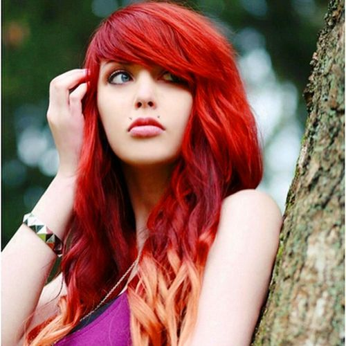 red hairstyle with side bangs for thick hair