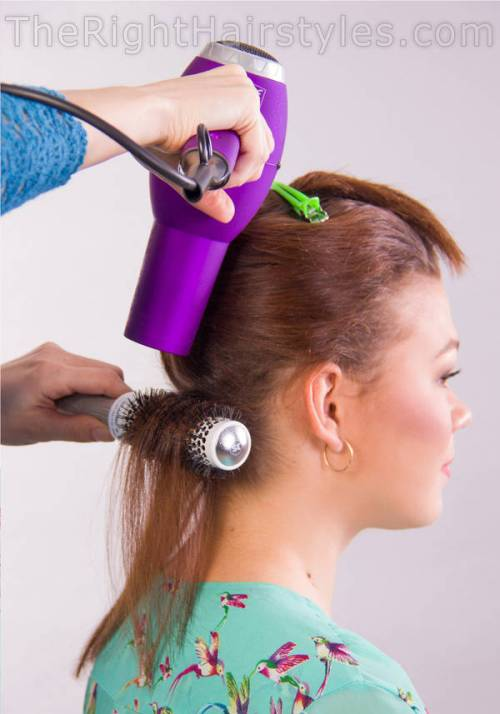 blow-drying with a round brush