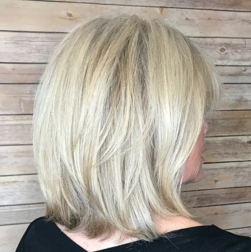 60+ Medium Layered Ash Blonde Hairstyle