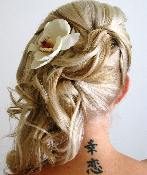 side wedding hairstyle with a flower