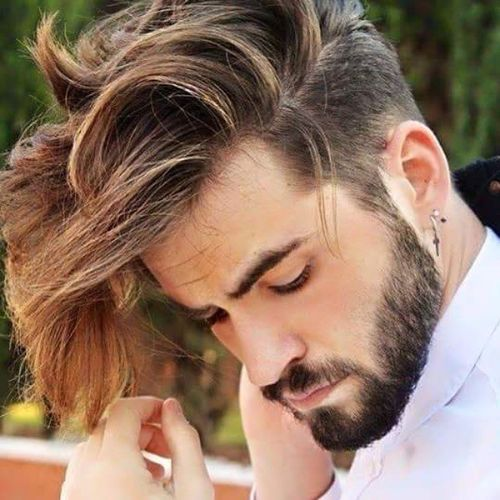 men's hairstyle with a long quiff