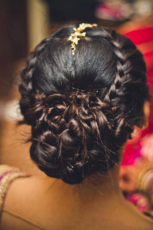 low bun hairstyle for Indian style wedding
