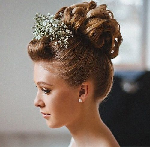 curly updo with pompadour bangs for shorter hair