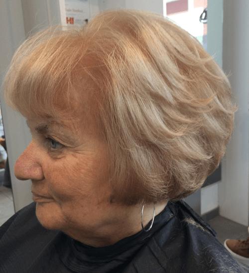 Short Layered Creamy Blonde Hairstyle