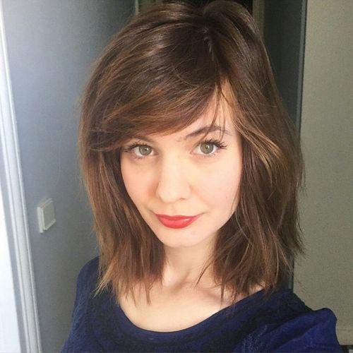 lob haircut with side bangs
