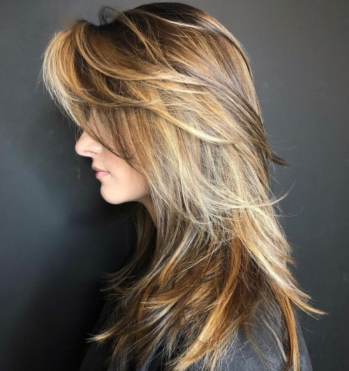 Layered Cut With Swoopy Bangs For Long Hair