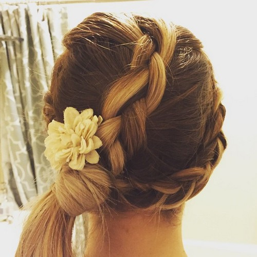 braided hairstyle with a side ponytail