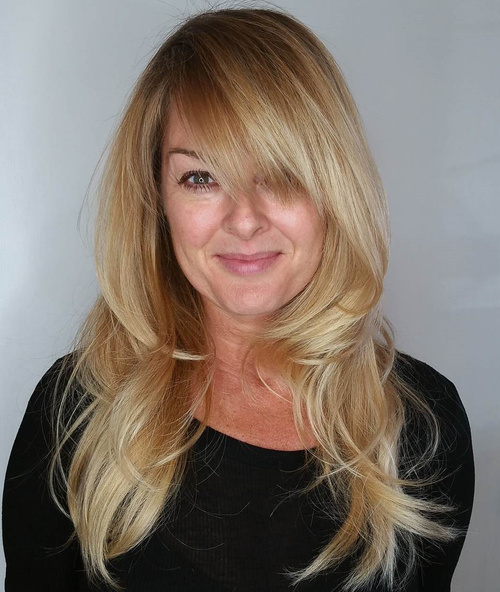 Charming Layered Blonde Hairstyle With Bangs For Long Hair