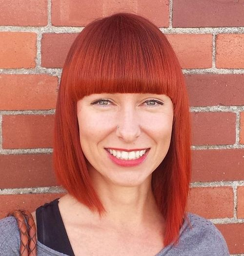red asymmetrical bob with straight bangs