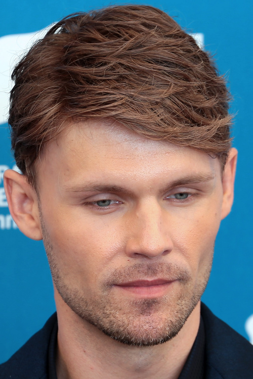 textured side-parted men's hairstyle
