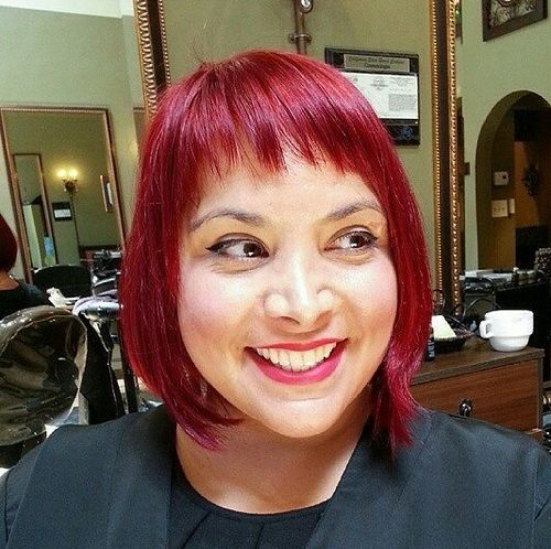red chin-length bob with point cut bangs