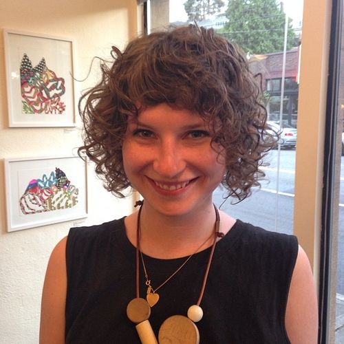 Short curly hairstyle with bangs for thin hair